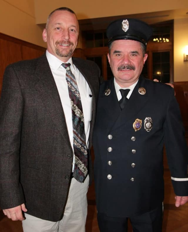 Todd Bender,left, with Vincent Galvin, right, of the Dutchess County Volunteer Firefighters Association.