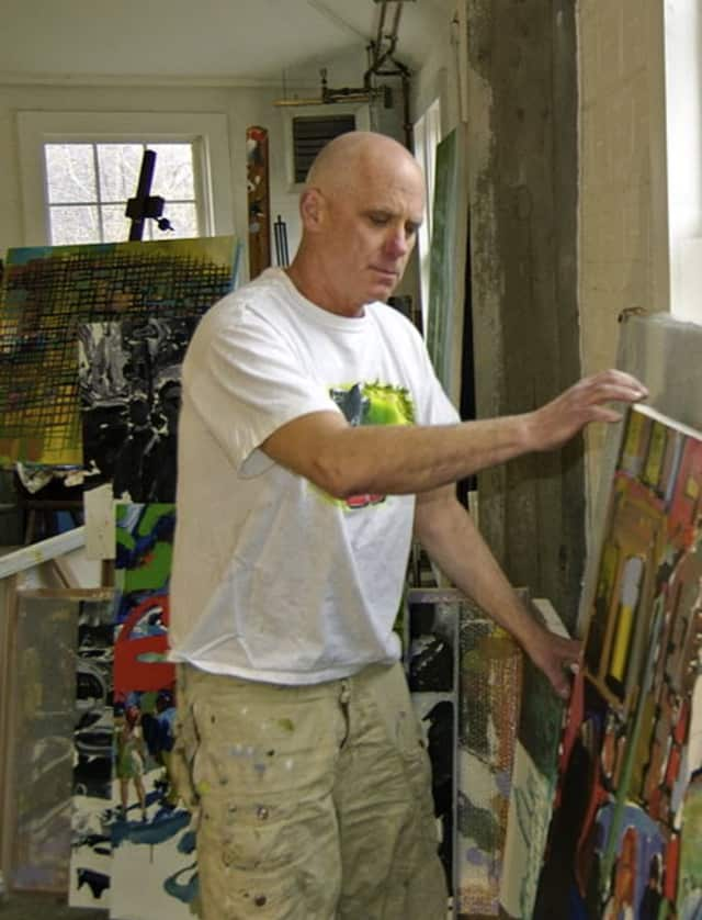 Artist Tom Christopher moving painting around his work space at Lift Trucks Project in Croton Falls, N.Y.