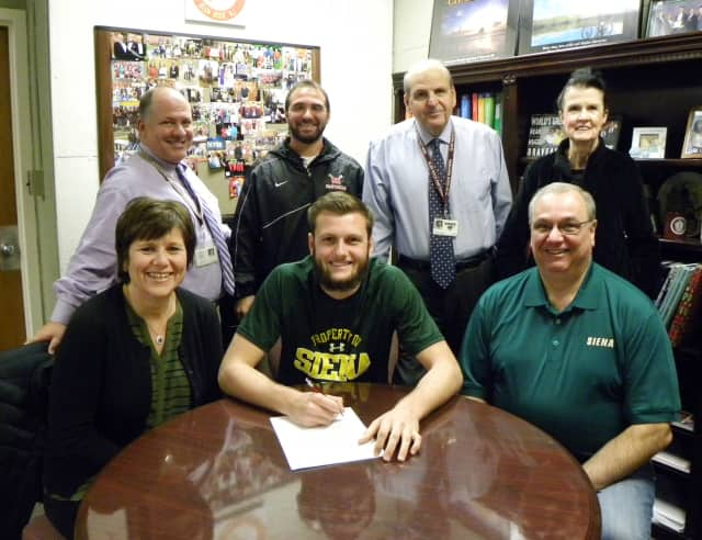 Glen Rock High School senior Tommy Pulzello is joined by his parents Mary Jane and Fred Pulzello as he signs his commitment letter to play Division 1 lacrosse for Siena College in New York.