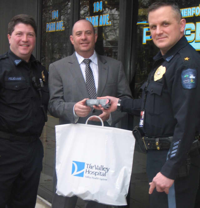 Rutherford Police Capt. Patrick Feliciano, Valley Director of Emergency Services Lafe Bush, Police Chief John Russo