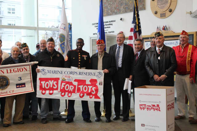 Stamford Mayor David Martin, state Sen. Carlo Leone, and others, kick off Toys for Tots month at a recent ceremony in Stamford,