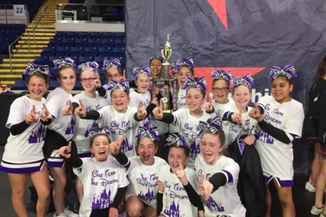Members of the Trumbull Pop Warner cheerleading squad are working hard to raise money to help defray the expense of traveling to a national competition in Florida next month.