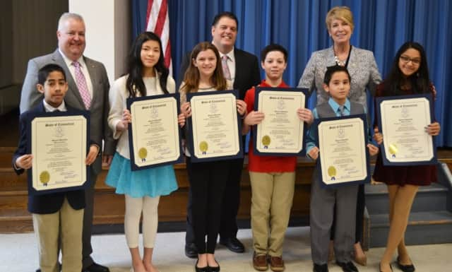 The Trumbull essay winners receive their awards.