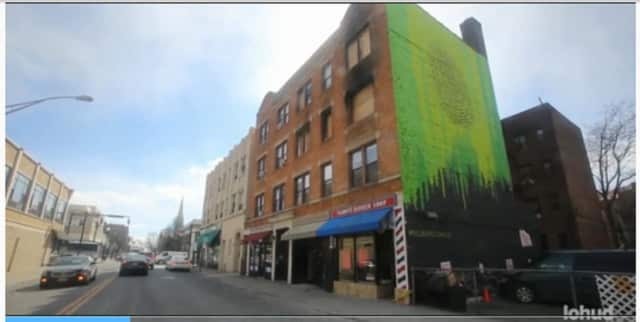New Rochelle firefighters rescued about 60 people from a two-alarm fire in the Centre Avenue apartment building.