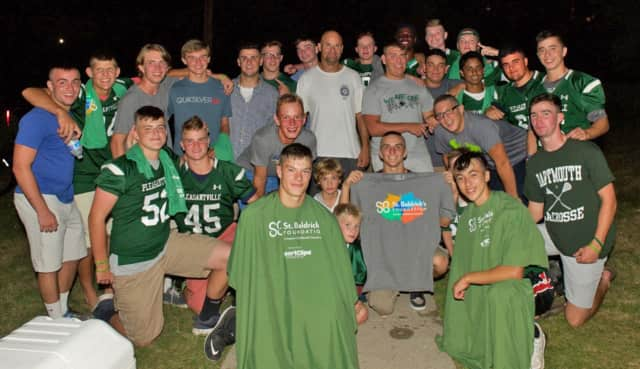 Pleasantville football players lost hair while raising money for cancer research.