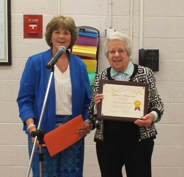 Photo caption: Lillian Spiegler (right) stands with Valhalla Superintendent Brenda Myers. Spiegler, a 100-year-old volunteer, was recognized with a special honor from the Valhalla Board of Education.