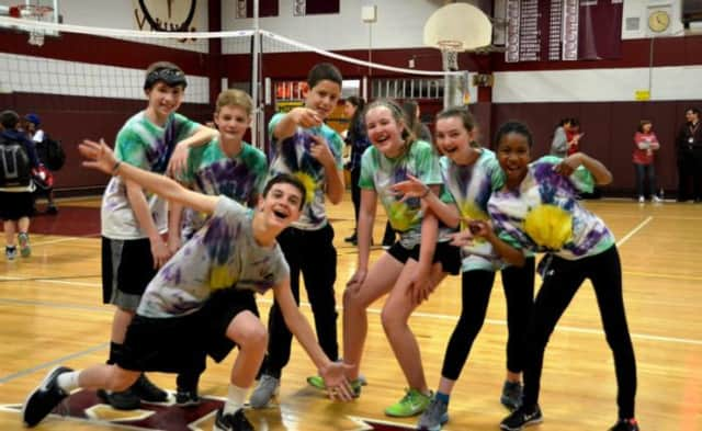 Students in handmade T-shirts at Valhalla Middle School competed with one another in a volleyball tournament to support the Ulman Cancer Fund for young adults with cancer.