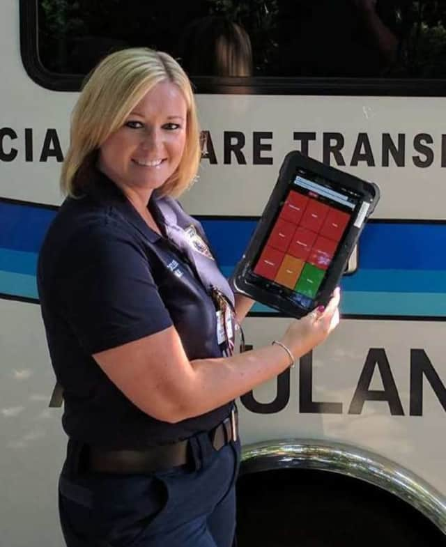 Tamara Baldesweiler, R.N., a member of Valley's Specialty Care Transport Unit, uses the Twiage app.