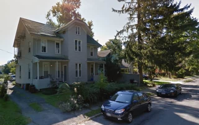 Dozens of volunteer firefighters responded to a smoldering fire on the porch of this multi-family home on Van Wyck Street in Croton on Hudson Sunday afternoon.