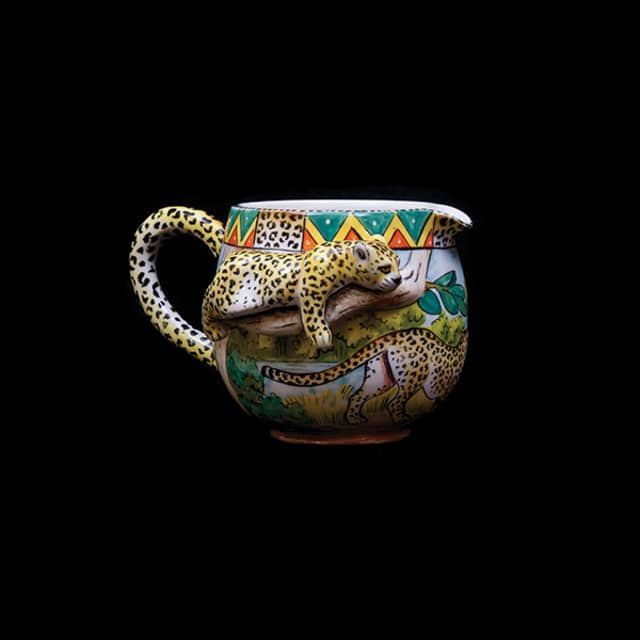 A cup for storing creamer. Photograph by Howard Zoubek.