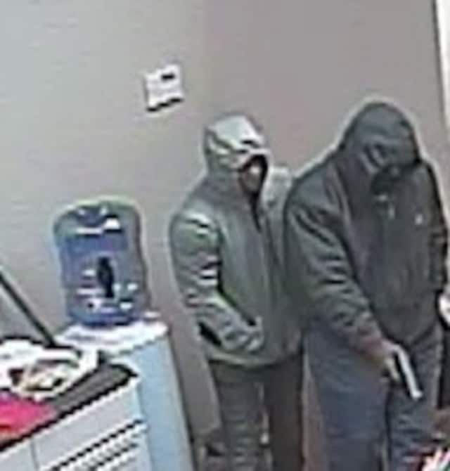 Police are seeking two men who are accused of stealing $20,000 worth of smart phones and iPads from a local Verizon store.