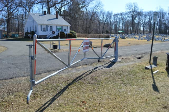 A gate was damaged at the Wyckoff Reformed Church Cemetery.
