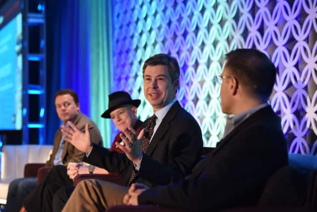 """Chattanooga Mayor Andy Berke discusses the """"perils of holding onto your past"""" at """"Westchester: County of Tomorrow"""" conference organized by the Westchester County Association. With him are Jason Widen, Susan Dawson and Seth Pinsky."""