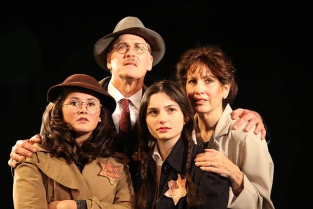 Avery Bebon as Margot, Jeff Pliskin as Mr. Frank, Deborah Burke as Mrs. Frank, and Katelyn Ferrari as Anne Frank, in the production.