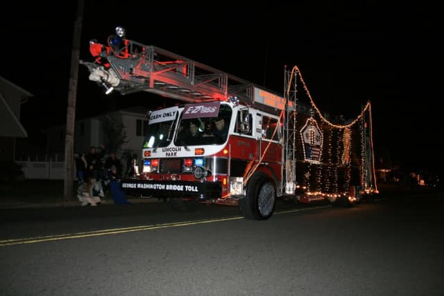 Participants may enter a float or lighted vehicle in the annual holiday parade.