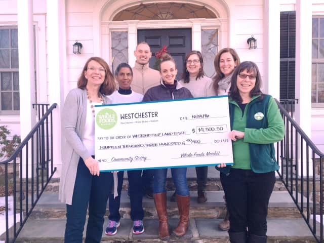 Westchester Land Trust members accept a donation from Whole Foods Market.