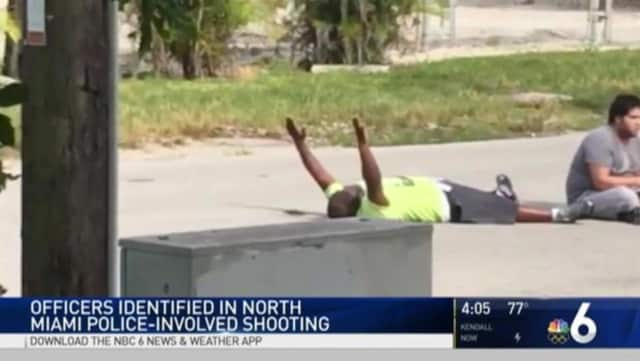 A screenshot shows behavior therapist Charles Kinsey as he was lying in the street with his hands in the air before he was shot by a North Miami police officer, who is originally from Westport.