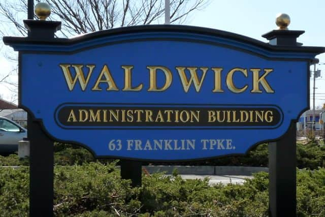 Waldwick's Board of Adjustment chairman, J. Patrick Hunter, has resigned and is moving his family to the historic Jacob Pulis farmhouse in Franklin Lakes.