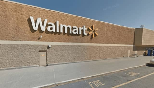A Poughkeepsie woman was arrested for stealing more than $1,400 worth of merchandise from an Ulster Walmart.