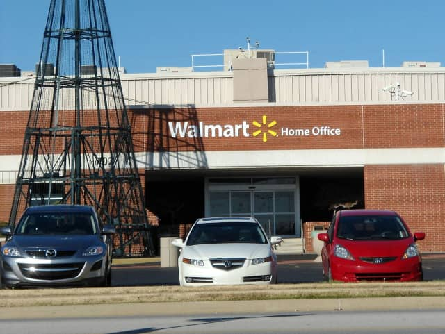 Wal-Mart Stores is testing home delivery through ride-sharing companies.