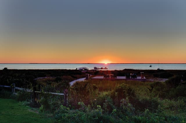 Sunset over Nantucket Bay, The Wauwinet. Photograph courtesy Nantucket Island Resorts.