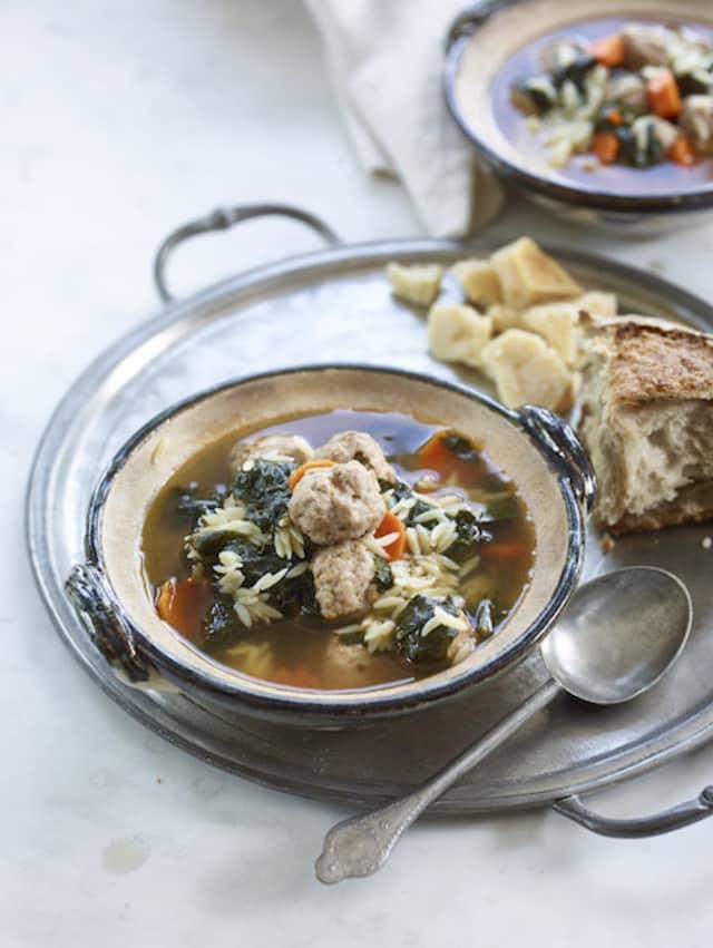 "Classic Italian Wedding Soup with crusty bread and chunks of Grana Padano. Photograph by Steve Giralt from Lidia Bastianich and Tanya Bastianich Manuali's new ""Lidia's Celebrate Like an Italian."""