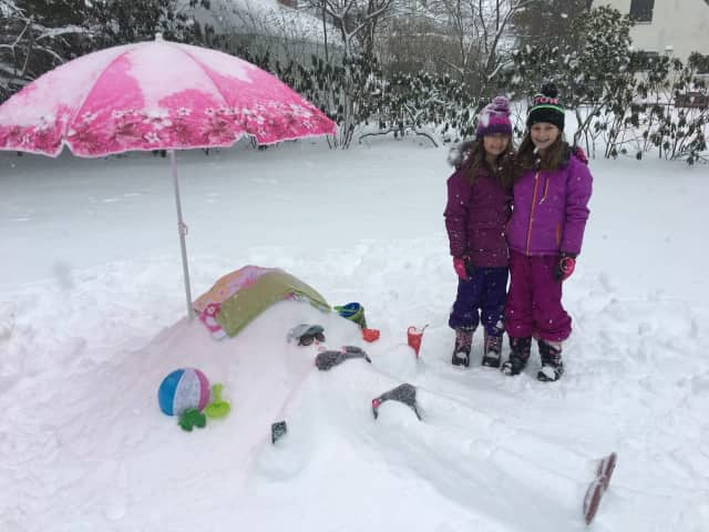 """The Weinberg-Barro family won the Grand Prize for their creation """"Day at the Beach in February."""""""
