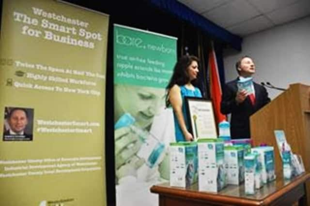 County Executive Rob Astorino recognized Priska Diaz for her business success.