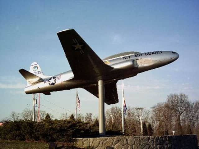 The New York Air National Guard Lockheed T-33B Shooting Star trainer is on display at one of the entrances to the Westchester County Airport.