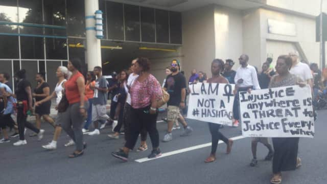 Hundreds march in White Plains on Thursday seeking reforms after the recent killings of two black men by police. They also mourned the loss of the Dallas officers who were gunned down at a rally last week.
