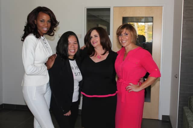 Gathering together for a special event Saturday at the Dyson Breast Center at Vassar Brothers Medical Center are from left, Angelline Smalls, Erika Hernandez, Kim Ross and Sara Winterleitner.