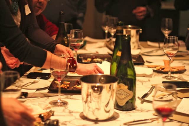 Hors d'oeuvres will be served by local restaurants and wine will be provided by Row 13 Wines.