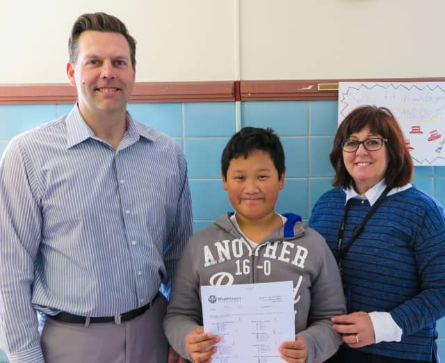 Ryan Raymundo with his fifth grade teacher, Erik Olson, and Franklin School Reading Specialist Joanne Mickolajczyk