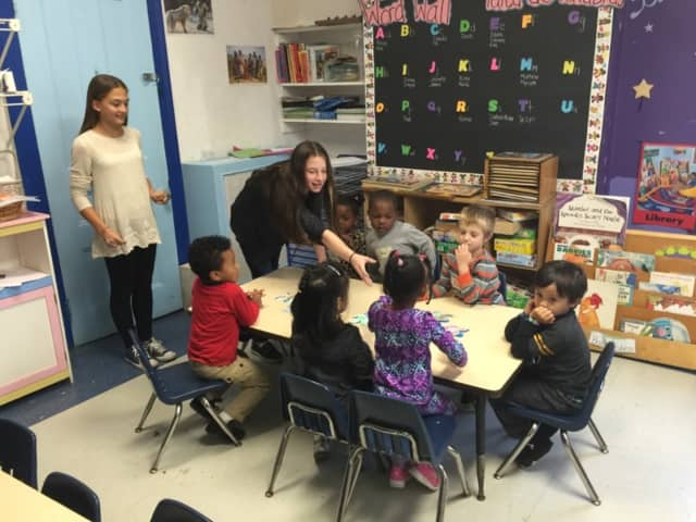 Seventh-grade Spanish and French classes are volunteering at the Ossining Children's Center once a month, where they are reading stories in the languages they are studying to the preschool children.