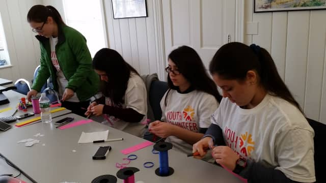 YVC volunteers working on a bookmark project.