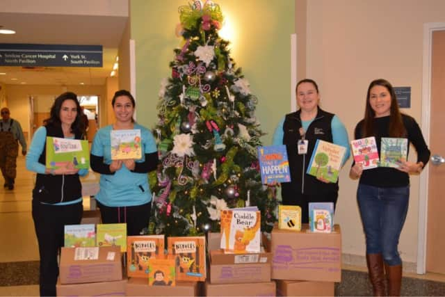 Fairfield teacher Kristin Golia raised about $3,500 to support a book drive for children with cancer at Yale-New Haven Hospital.