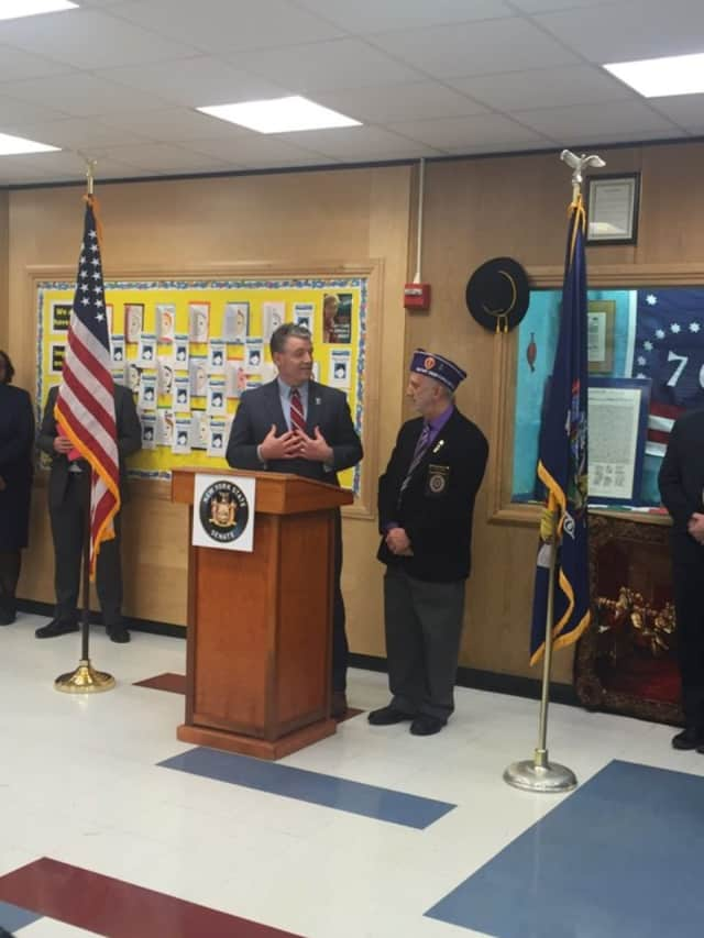 Senator Terrence Murphy honors Vietnam veteran Eugene Lang of Yorktown with a spot on the 40th State Senate District Veterans Wall of Fame during a recent ceremony at Mildred E. Strang Middle School.