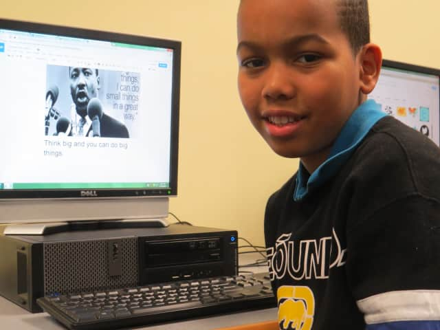 Fourth-grader Brandon Montero shows off a Martin Luther King quote on his desktop computer at Crompond Elementary School in Yonkers.