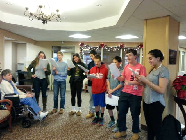 Members of Yorktown's SADD group from the high school sang holiday songs to residents of Field Home Wednesday.