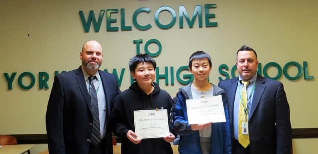 Yorktown High School Assistant Principal John Gollisz, students Eric Lu and Kenny Zhang, and Principal Joseph DeGennaro