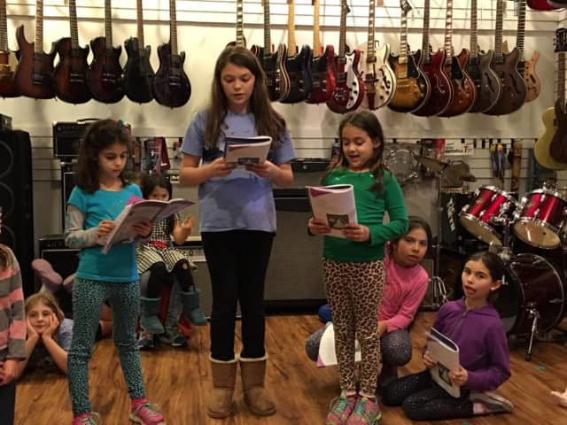 "Students from Mike Risko Music school prepare for their parts in the upcoming production of ""Disney Sleeping Beauty Kids,"" on April 7 and April 9."