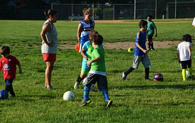 Younger kids have at it during a 2014 AYSO soccer clinic.