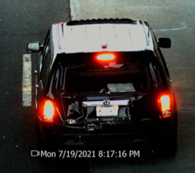 Police are asking the public for help locating a black SUV involved in a fatal crash.