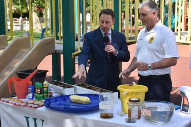 Westchester County Executive Rob Astorino and Peter DeLucia, assistant commissioner for environmental health, discuss ways to reduce mosquito populations.