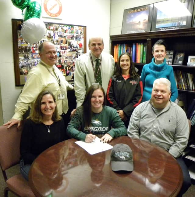 Glen Rock High School senior Zoe Bender is congratulated by her parents Carolyn and Jeffrey after she commits to play softball at Wagner College.