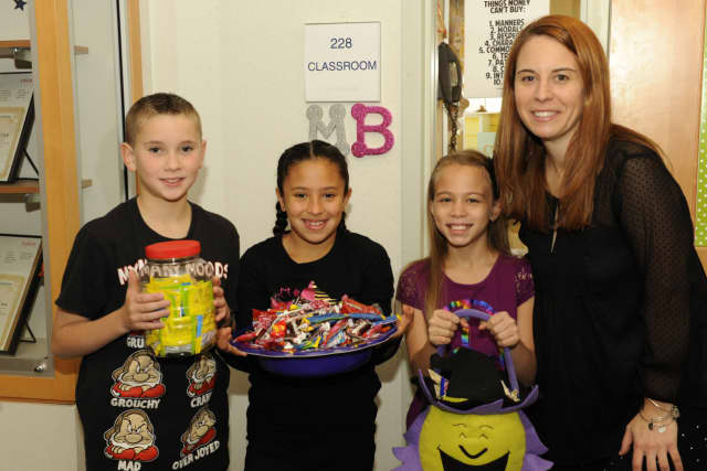 Pictured: Gavin Stallone, Liana Villalobos, Giuliana Diaz with fourth grade teacher Maura Barrett.