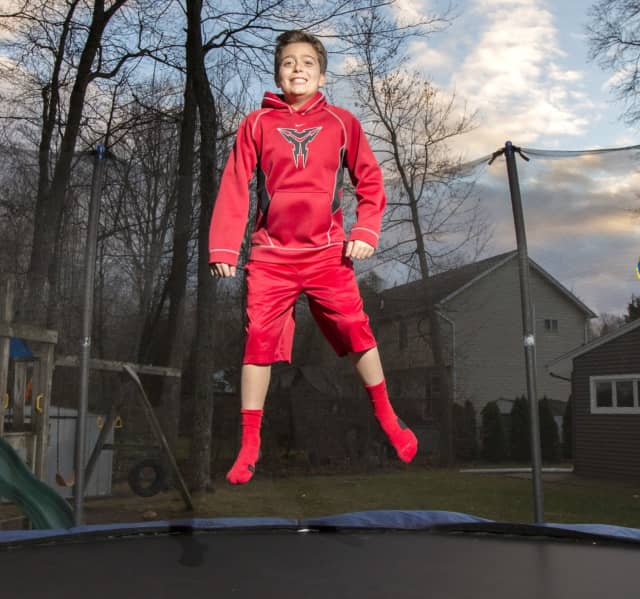 Jimmy Miele is able to jump on his trampoline and play sports after being treated by Dr. James Charles, a headache specialist and neurologist at Holy Name Medical Center, for an unrelenting migraine that lasted for weeks.