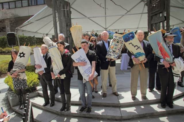 The 2015 Westchester Holocaust Commemoration event featured the procession of rescued Torahs. This year's ceremony is May 5 in White Plains.