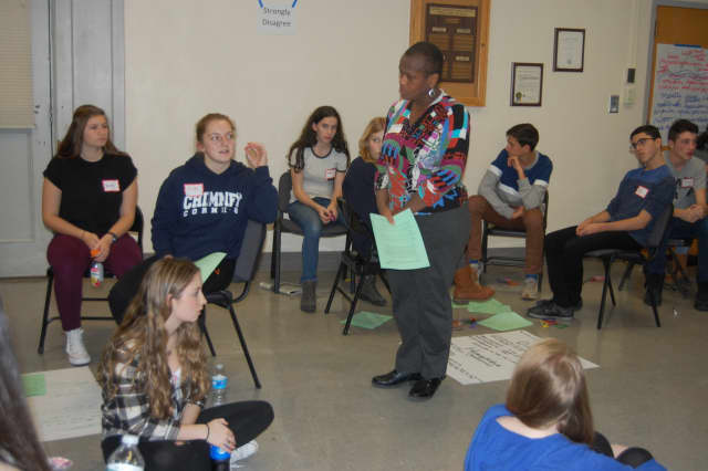 """Joan Grangenois-Thomas from the Anti-Defamation League leads discussion among Hasting High School students in the anti-bias education program called """"A World of Difference."""""""