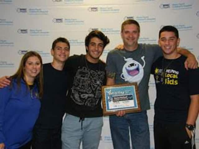 New Rochelle High School students Jack Dubicki, Nick Fazio and Chris Hough with Nintendo representative Kevin Pritchard and Meredith Buono from Maria Fareri Children's Hospital.